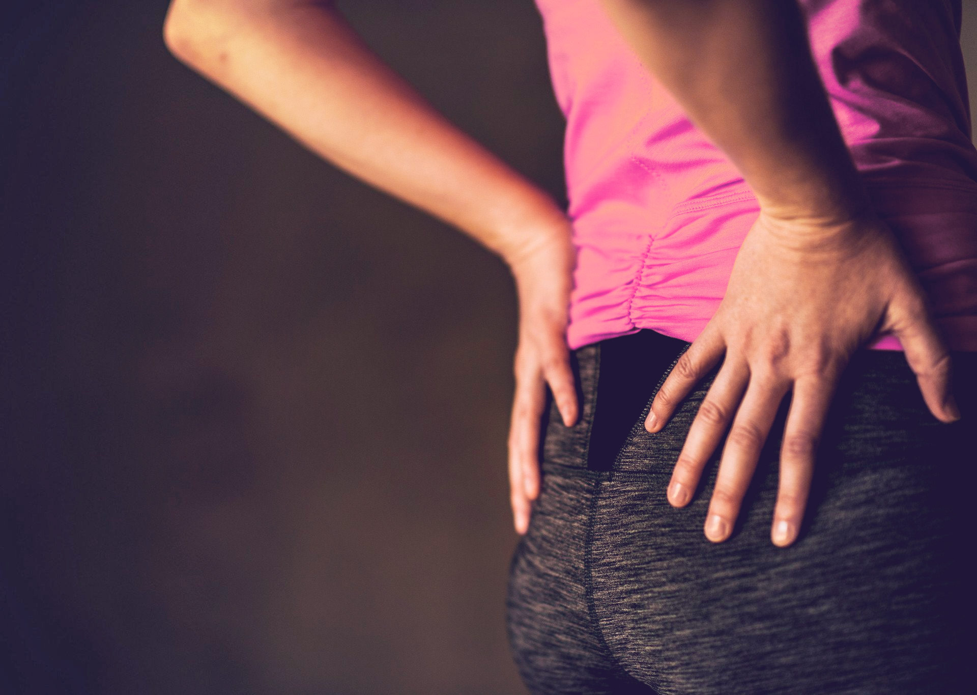lower-back-pain-inflammation-woman-hands