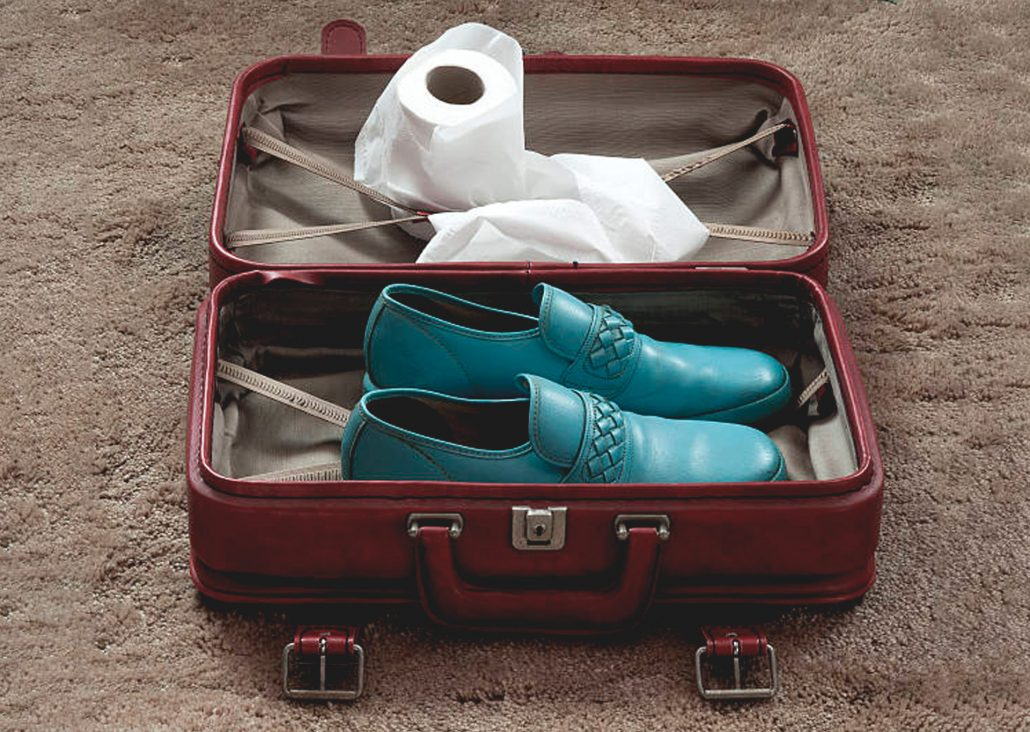 suitcase containing only shoes and toilet paper