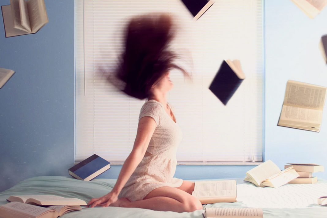 stressed girl throwing books
