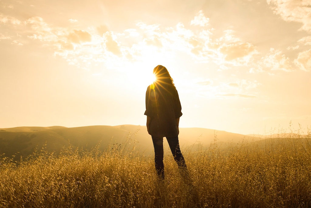 girl-standing-in-sunlight-golden-hour