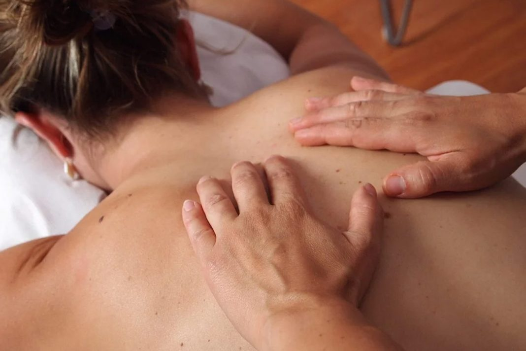 massage-hands-womans-back-shoulders